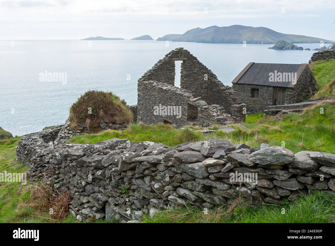 Ruins of a house near Slea Head and part of the Blasket Islands, the most Western point of Europe, Dingle Peninsula, Republic of Ireland. Stock Photo