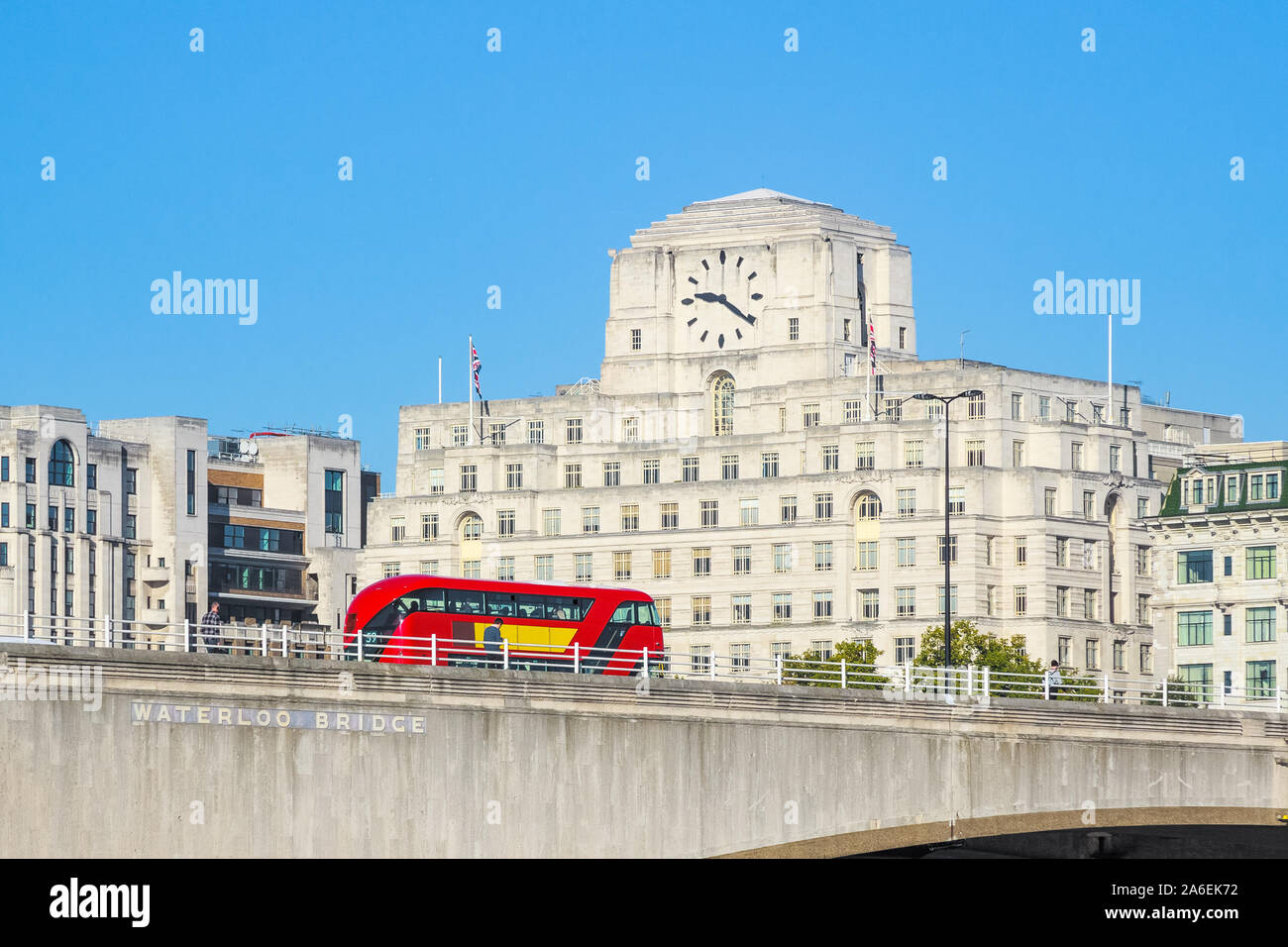 Waterloo Bridge with a passing bus and facade of Shell Mex House in the background in London Stock Photo