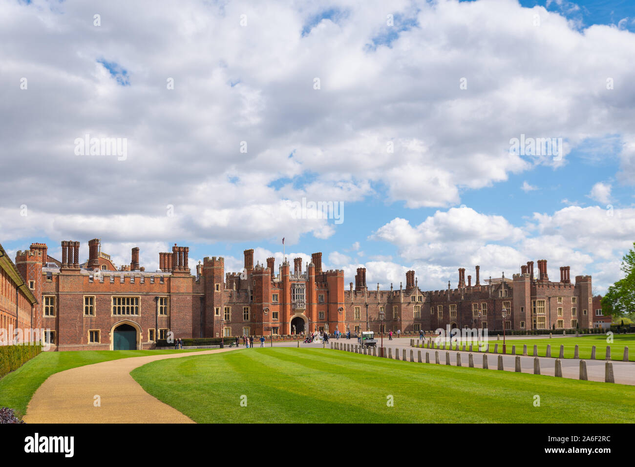 Main entrance to Hampton court Palace on a sunny and cloudy day Stock Photo