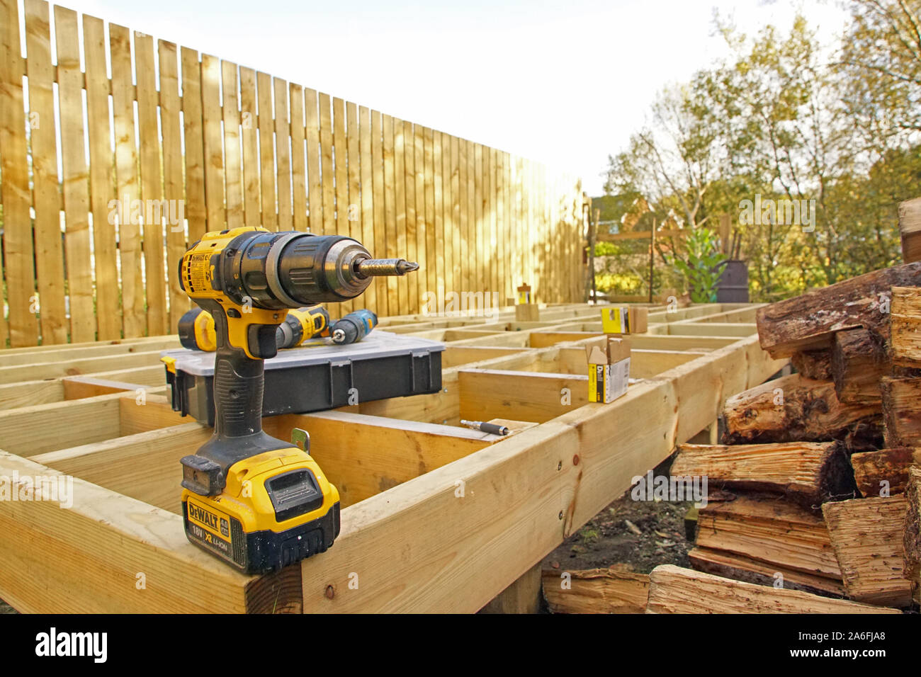 DeWalt Drill on a Frame from Raised Deck in Garden, DIY, Do It Yourself, Gardening, Garden Work Stock Photo
