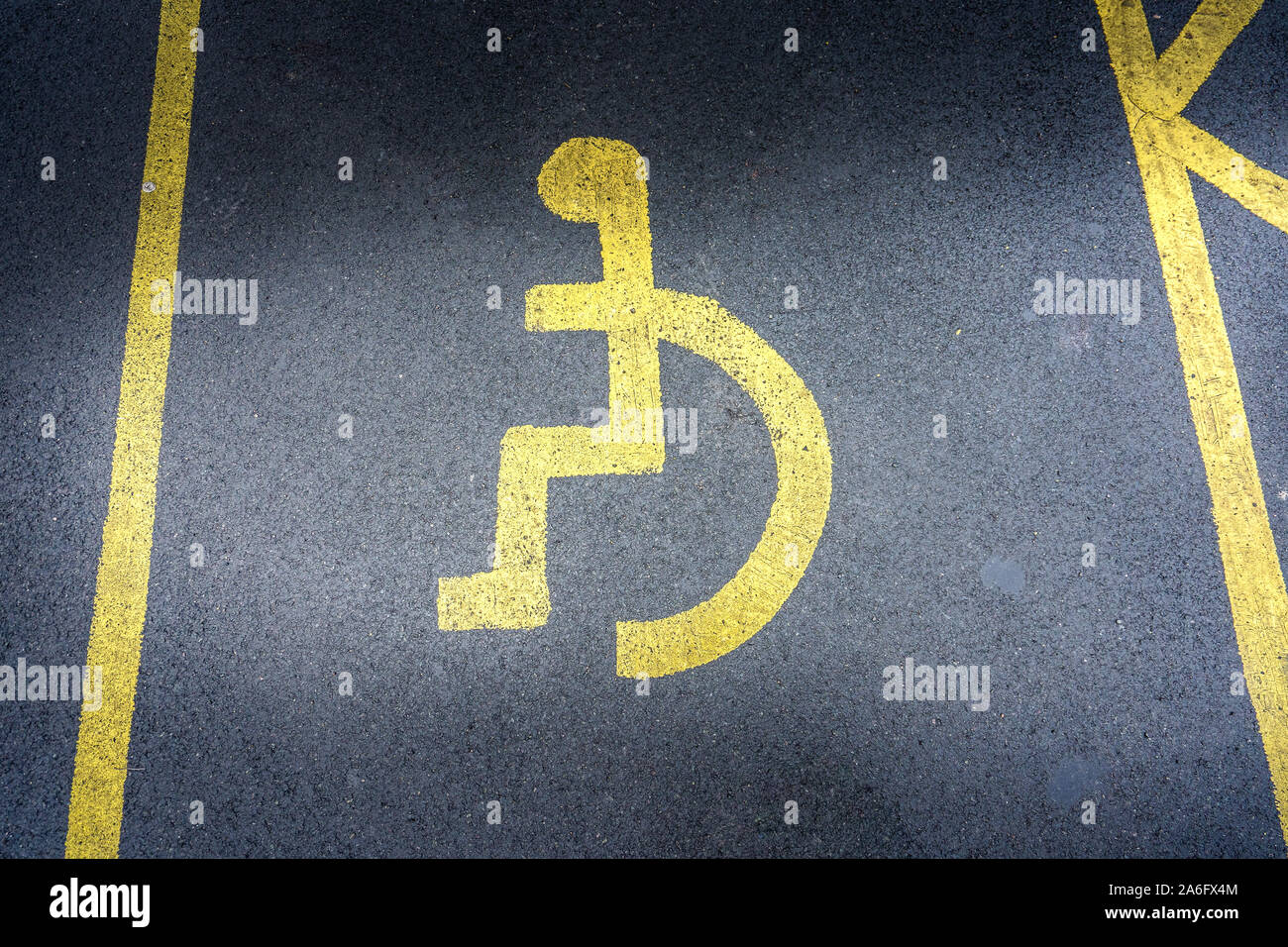 Disabled parking space, handicapped parking spot, the universal sign for people with wheelchairs and disabilities. Disabled badge holds, blue badge Stock Photo