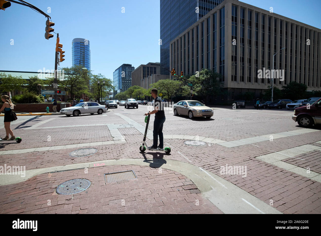 man on lime escooter in downtown city of indianapolis indiana USA Stock Photo