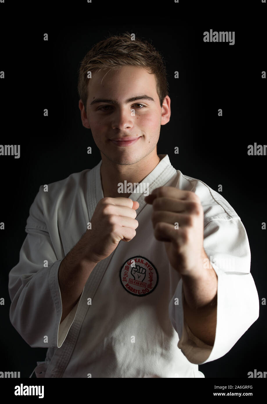 A handsome young man in his karate gi, suit, Stock Photo