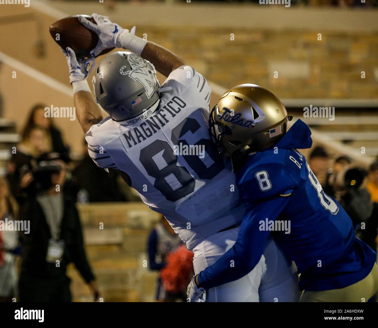 Tulsa, OK, USA. 26th Oct, 2019. Memphis Tight End JOEY MAGNIFICO (86) catches a pass in the endzone over Tulsa defender BRANDON JOHNSON (8) during the Tulsa vs Memphis game on Oct 26th, 2019 at H.A Chapman Stadium in Tulsa, OK. Credit: Shane Cossey/ZUMA Wire/Alamy Live News Stock Photo