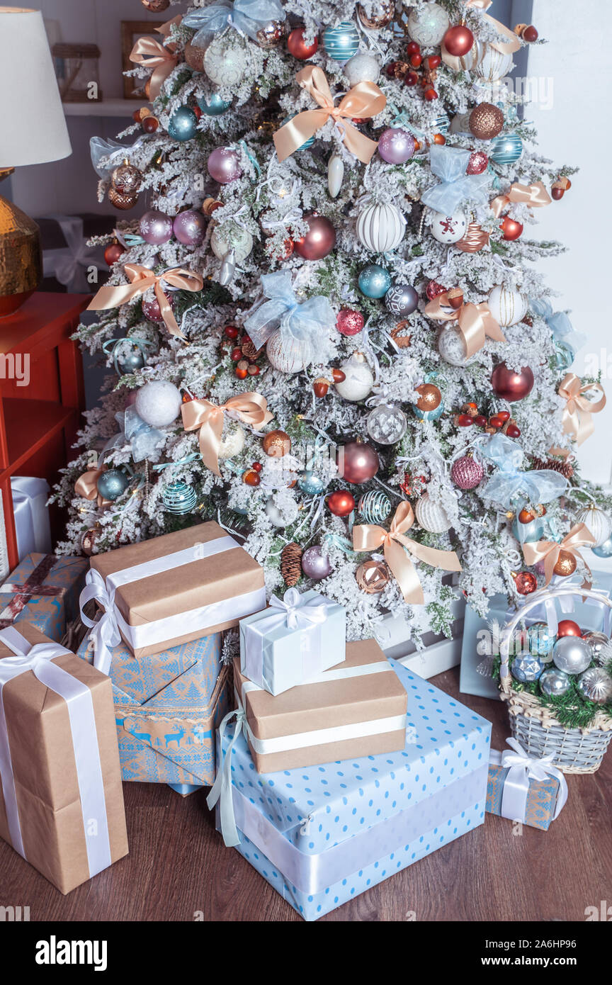 White Decorated Christmas Tree With Many Gifts Underneath In Gentle Pastel Colors Good New Year Spirit Stock Photo Alamy