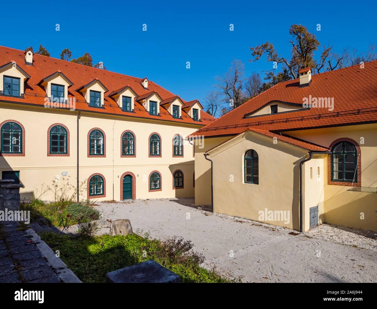 Demonstrative farm village property near Sneznik castle in Slovenia Stock Photo