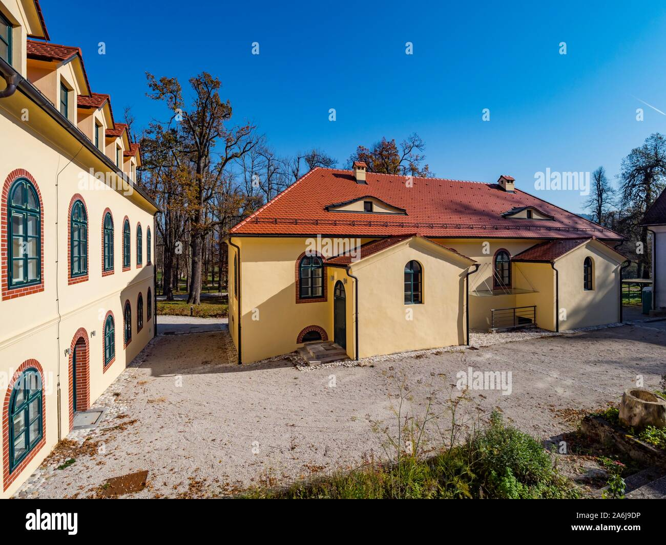 Demonstrative farm village property near Sneznik castle in Slovenia Stock Photo