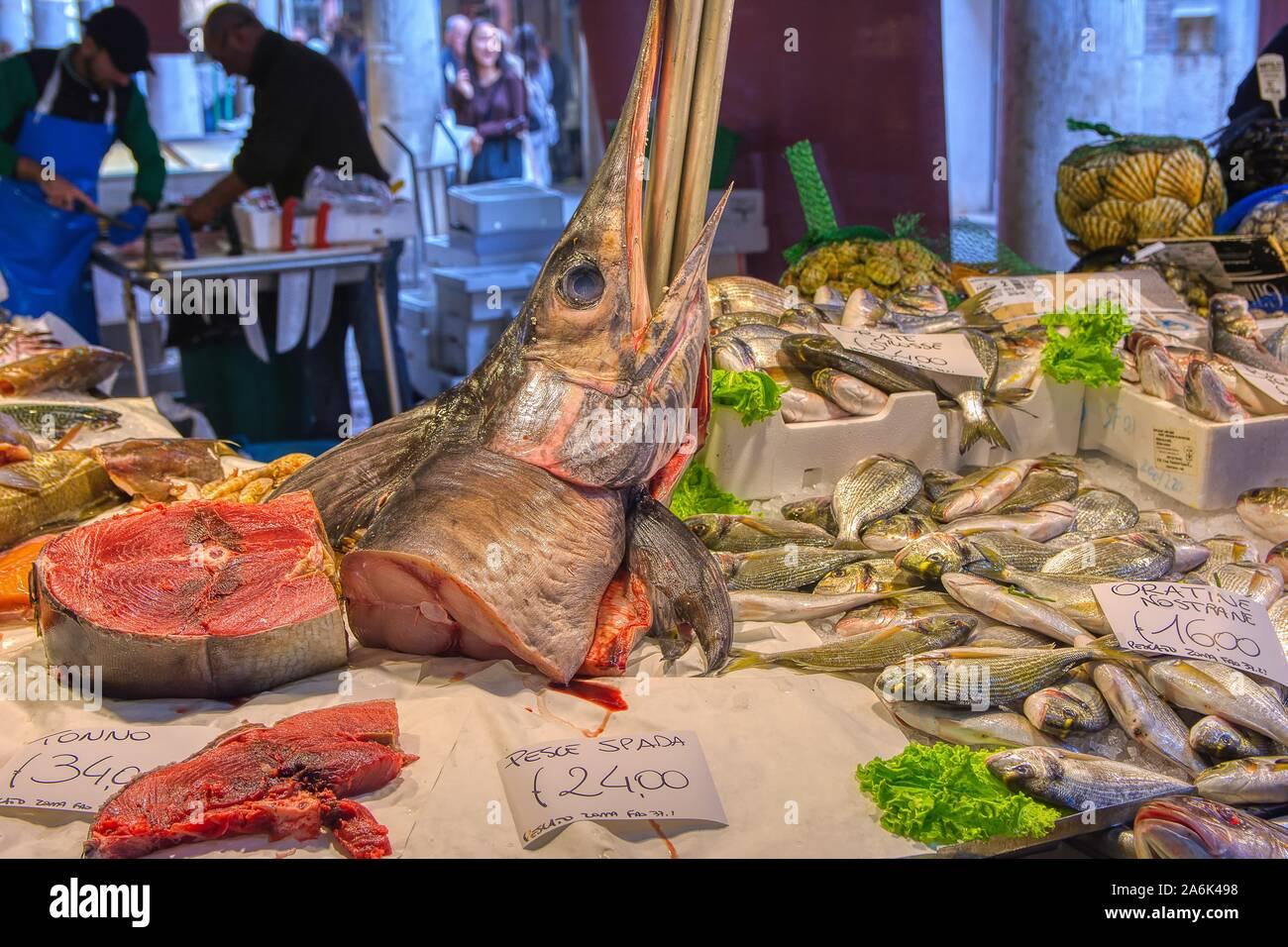 Venice, Italy - October 12, 2019: Fresh seafood for sale at the Rialto farmers market ,Mercato di Rialto, in Venice near the Rialto Bridge and the Gra Stock Photo