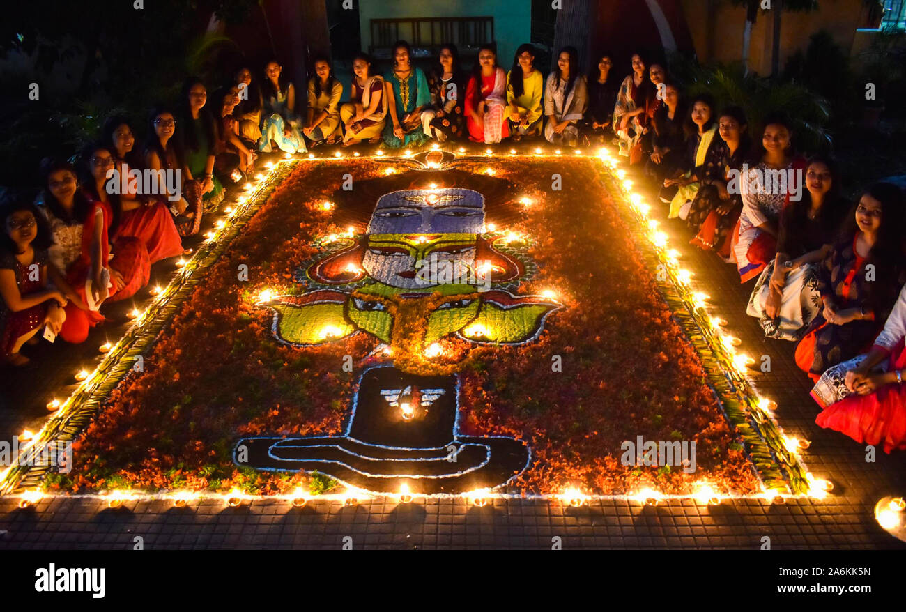 Assam, India. October 27, 2019. Students of Cotton University decorating Rangoli with Diyas (earthern lamps) on the occasion of Diwali festival in Guwahati on Sunday. Photo: David Talukdar/ Alamy Live News Stock Photo