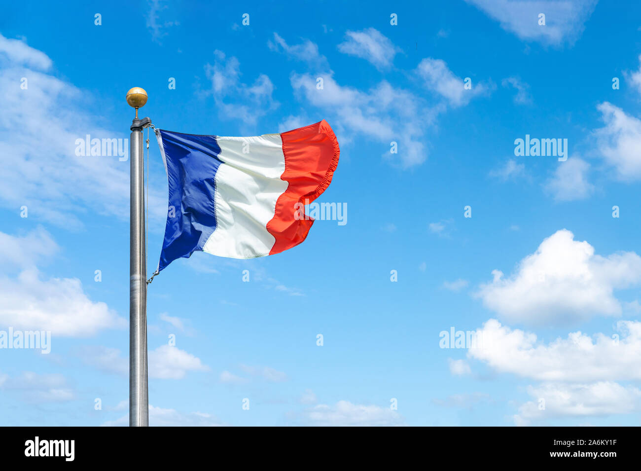 French flag against a blue sky background Stock Photo