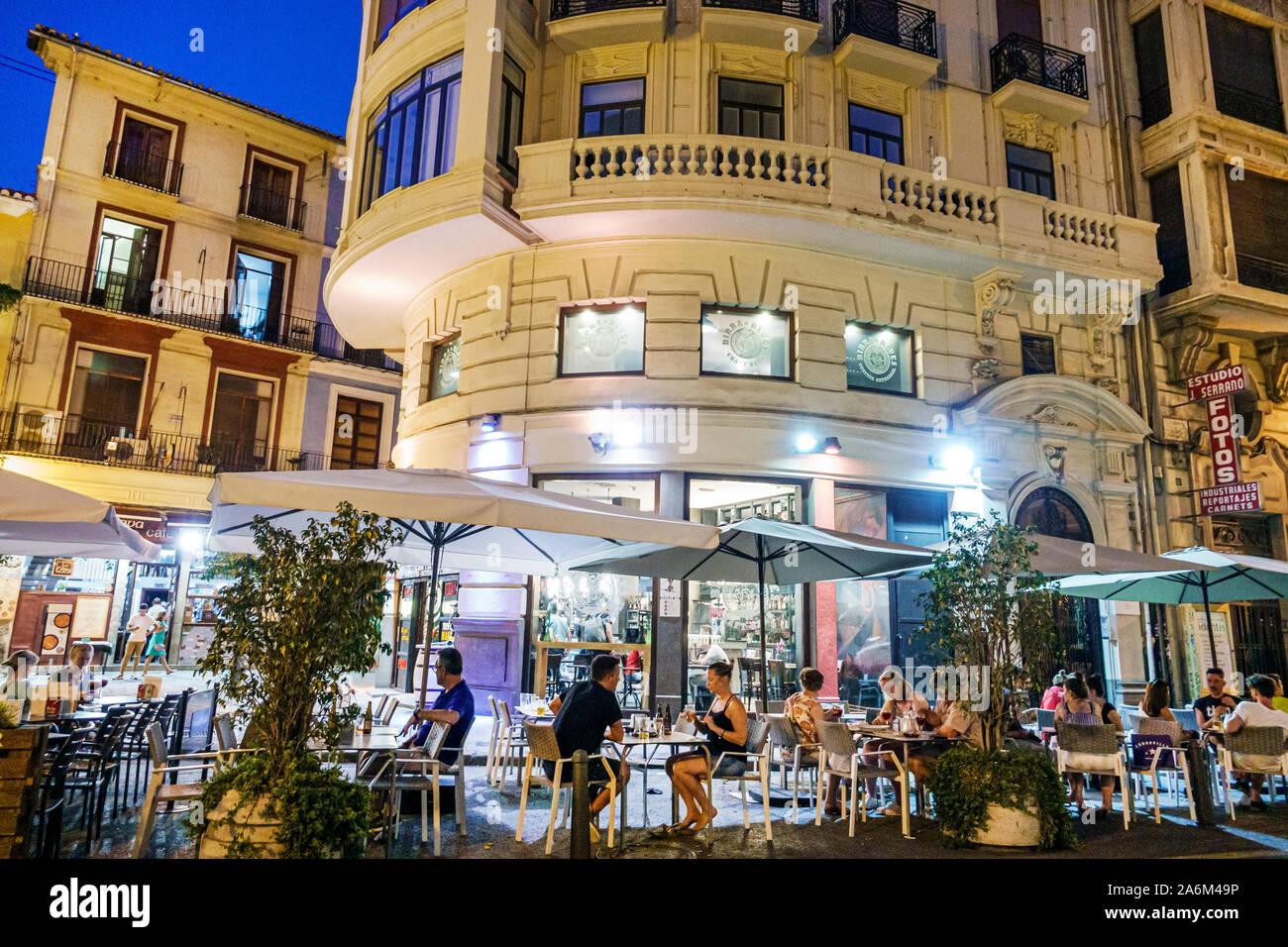 Valencia Spain Hispanic,Ciutat Vella,old city,historic center,Plaza del Mercat,Birra & Blues,restaurant,bar,night evening,al fresco dining,tables,umbr Stock Photo