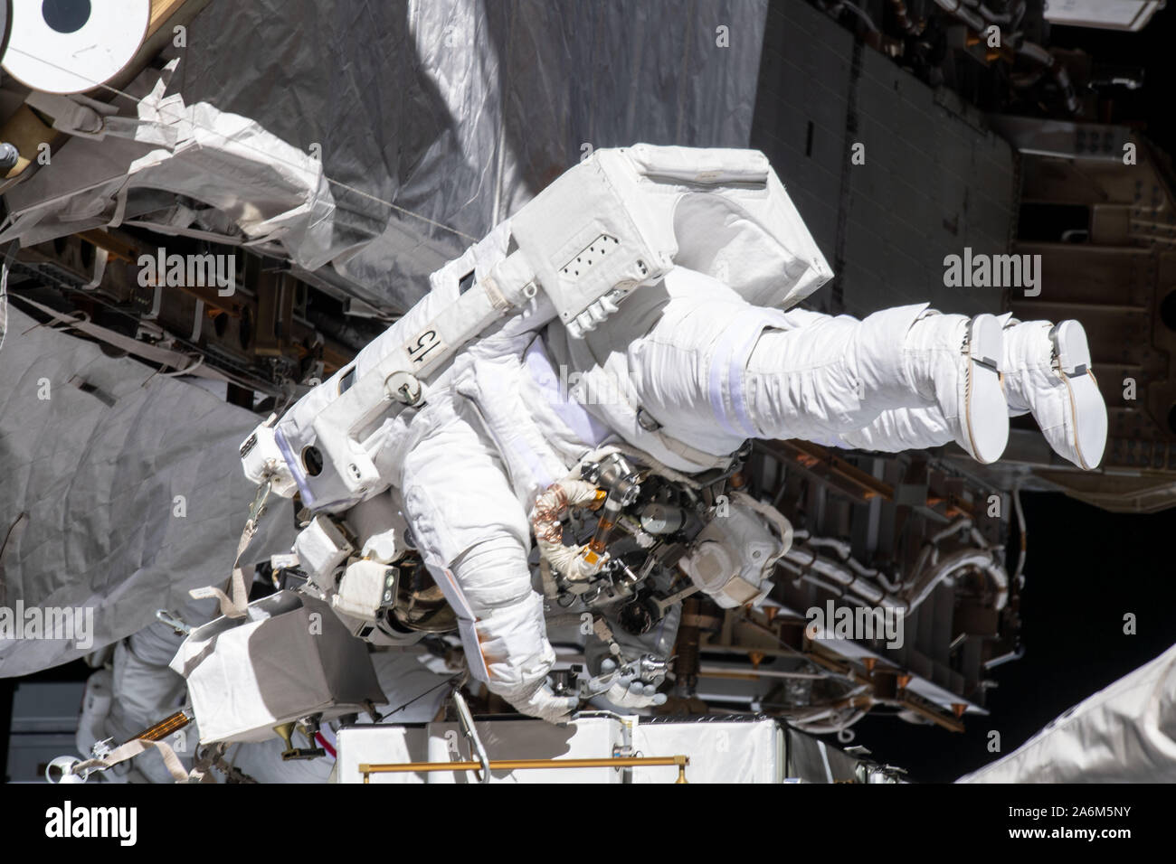 NASA astronaut Christina Koch works while tethered near the Port 6 truss segment of the International Space Station to replace older hydrogen-nickel batteries with newer, more powerful lithium-ion batteries, during the October 11, 2019, spacewalk. Stock Photo