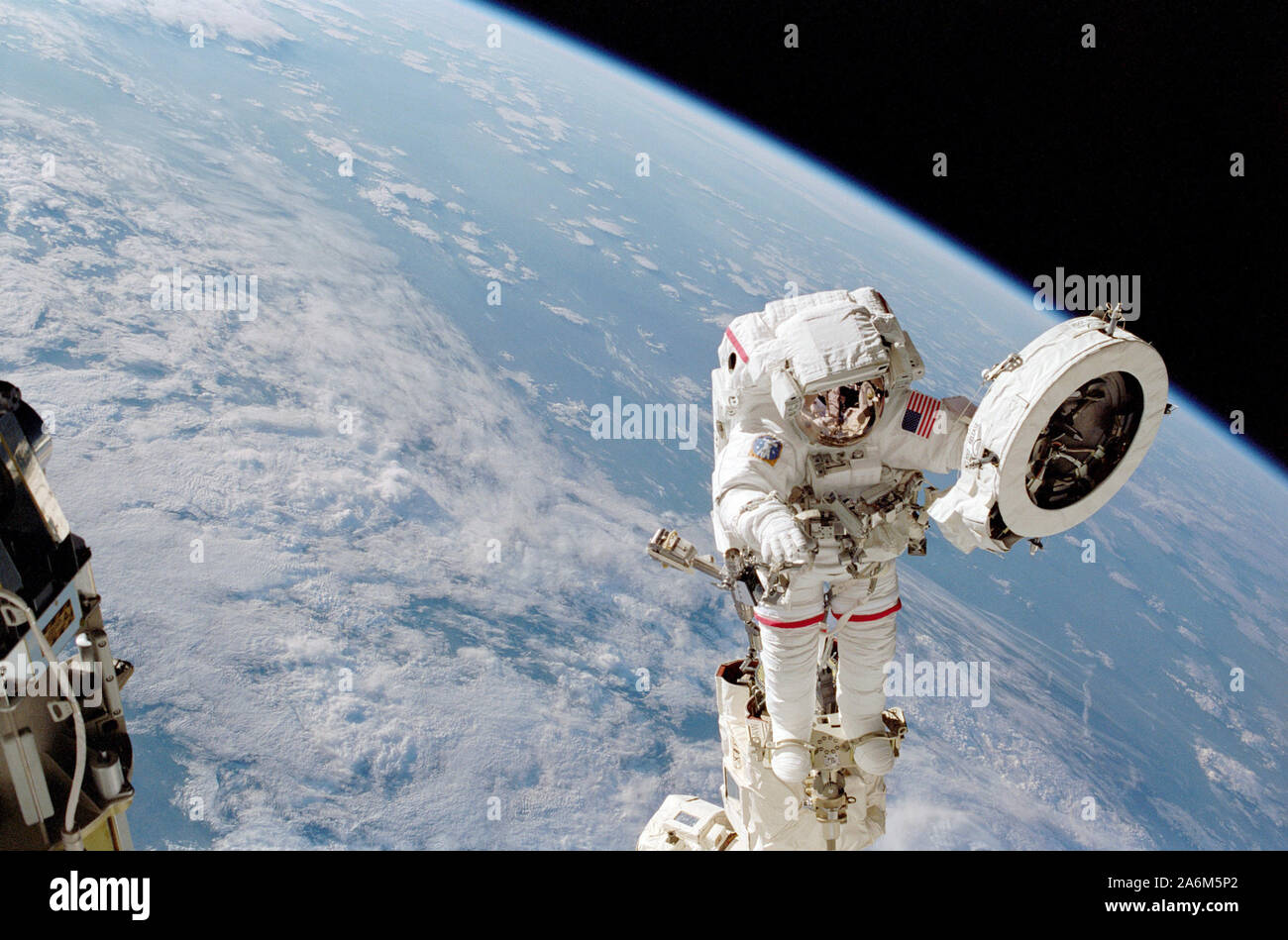 Astronaut Franklin R. Chang-Diaz works with a grapple fixture during extravehicular activity (EVA) to perform work on the International Space Station (ISS) Stock Photo
