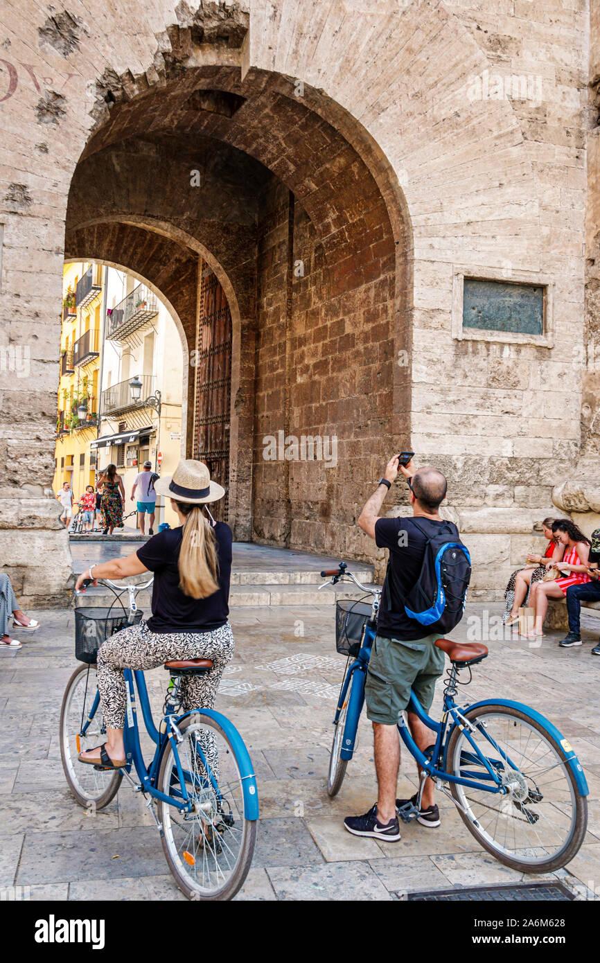 Spain,Valencia,Ciutat Vella,old city,historic district,Torres de Quart,Gothic style defensive towers,city gate,archway,1400s,historical landmark,man,w Stock Photo