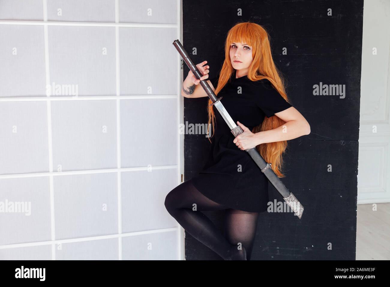 Girl sword Japan cosplayer anime red hair Stock Photo - Alamy