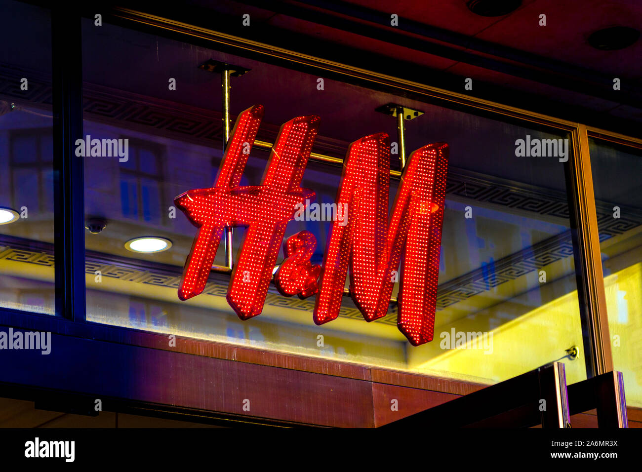 Lit up sign for the fashion retail giant H&M in Regent Street, London, UK Stock Photo