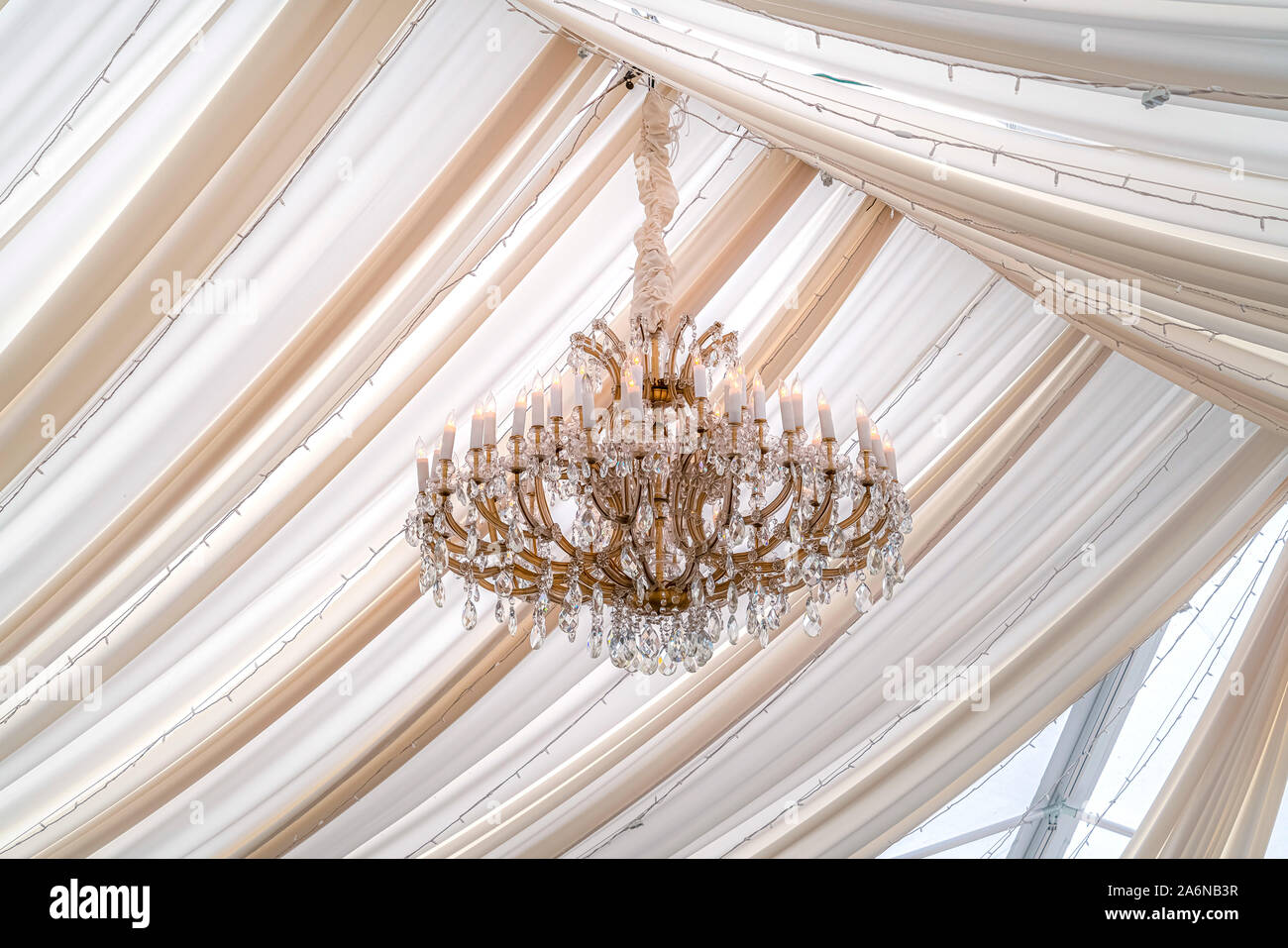 Beautiful Chandelier With Crystals And Faux Candles At A Wedding Venue Stock Photo Alamy