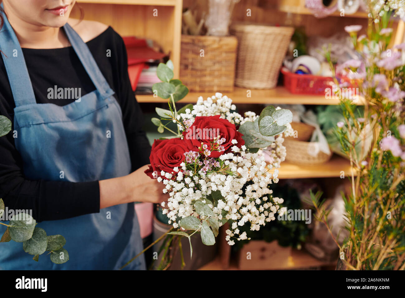 Female Florist Showing Beautiful Bouquet With Red Roses Gypsophila And Eucalyptus Stock Photo Alamy