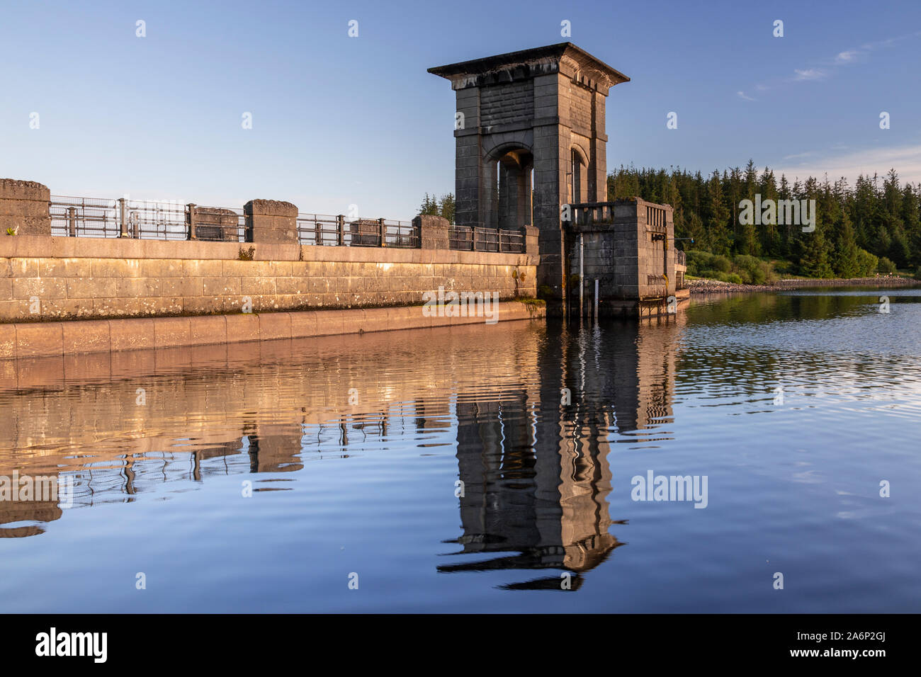 Alwen reservoir dam with reflection, North Wales on a sunny afternoon Stock Photo
