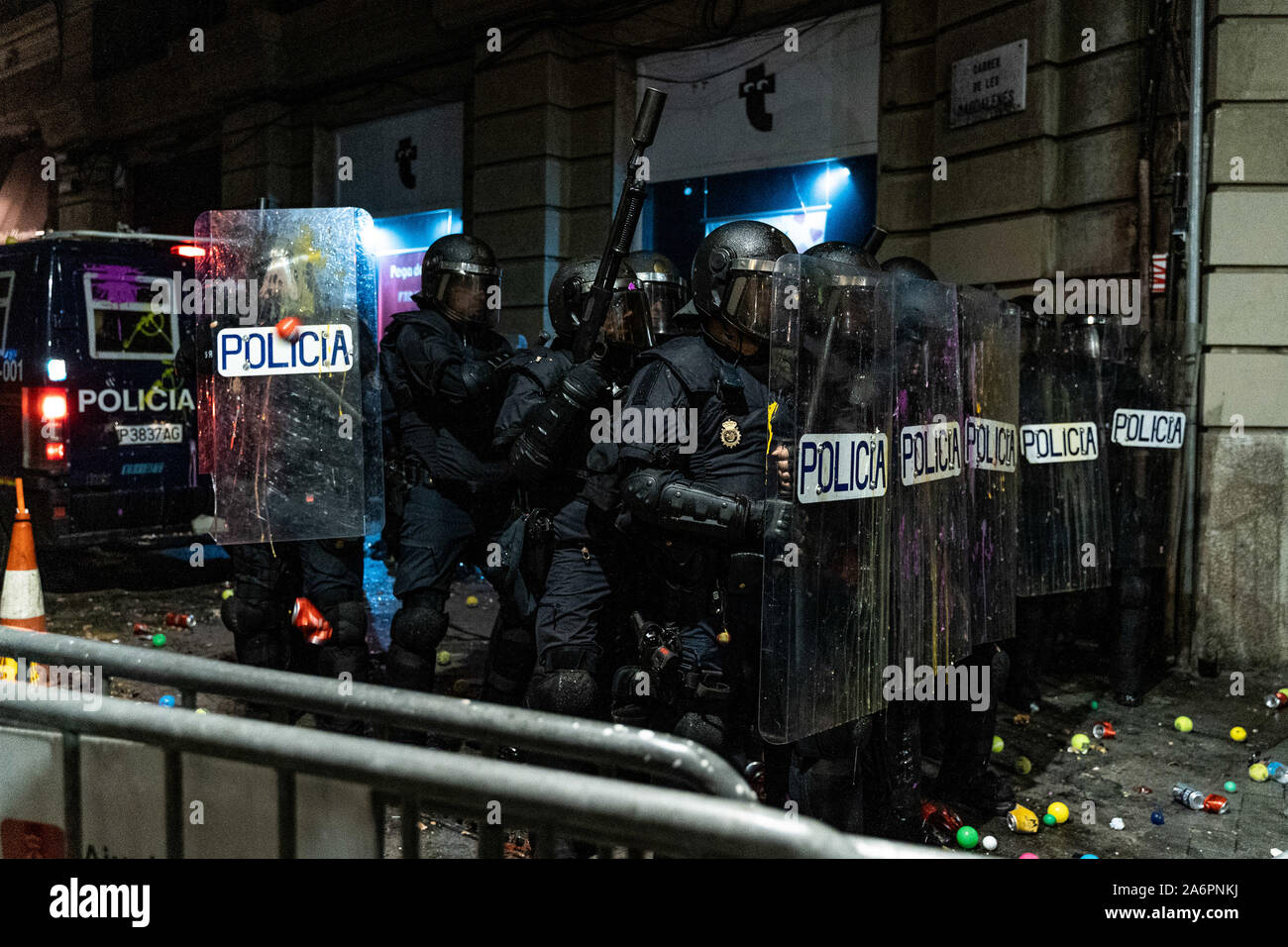 Barcelona, Spain. 26th Oct, 2019. Policemen stand in line to push back protesters near the headquarters of the Spanish National Police force in Barcelona, Spain, on Oct. 26, 2019. Credit: Joan Gosa/Xinhua/Alamy Live News Stock Photo