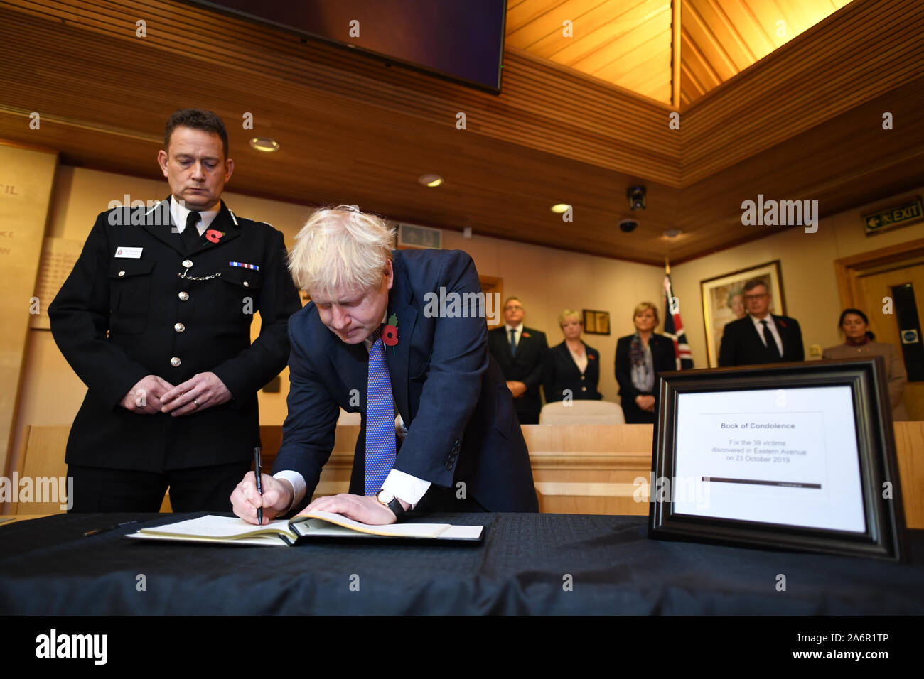 Prime Minister Boris Johnson signs a book of condolence during a visit to Thurrock Council Offices in Essex after the bodies of 39 people were found in a lorry container last week. Stock Photo