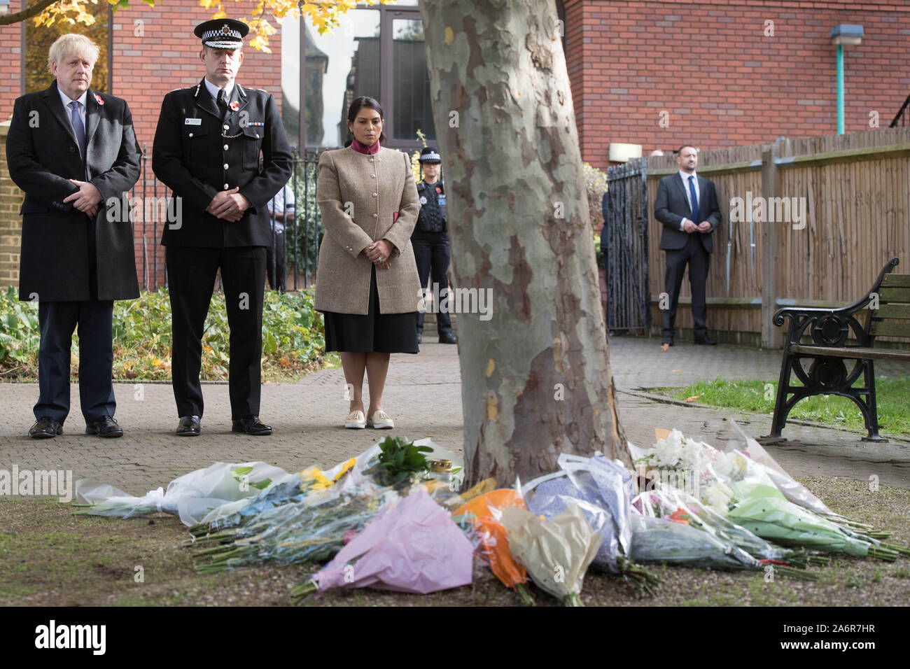 Prime Minister Boris Johnson stands with the Chief Constable of Essex Police, Ben-Julian Harrington and Home Secretary Priti Patel, after laying flowers during a visit to Thurrock Council Offices in Essex after the bodies of 39 people were found in a lorry container last week. Stock Photo