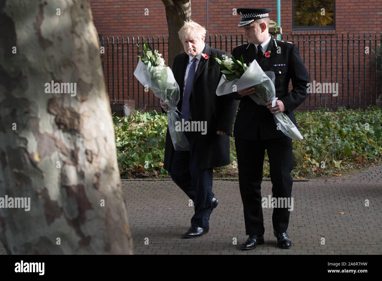 Prime Minister Boris Johnson walks with the Chief Constable of Essex Police, Ben-Julian Harrington, ahead of laying flowers during a visit to Thurrock Council Offices in Essex after the bodies of 39 people were found in a lorry container last week. Stock Photo