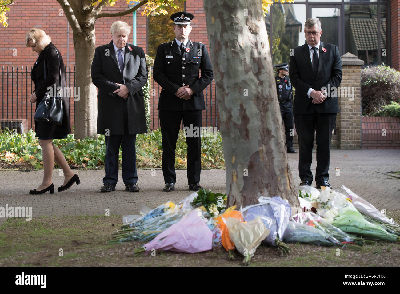 Prime Minister Boris Johnson stands with the Chief Constable of Essex Police, Ben-Julian Harrington, after they laid flowers during a visit to Thurrock Council Offices in Essex after the bodies of 39 people were found in a lorry container last week. Stock Photo