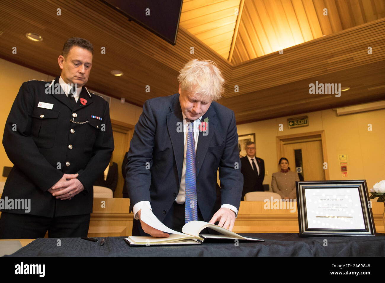 Prime Minister Boris Johnson signs a book of condolence, watched by the Chief Constable of Essex Police, Ben-Julian Harrington, during a visit to Thurrock Council Offices in Essex after the bodies of 39 people were found in a lorry container last week. Stock Photo