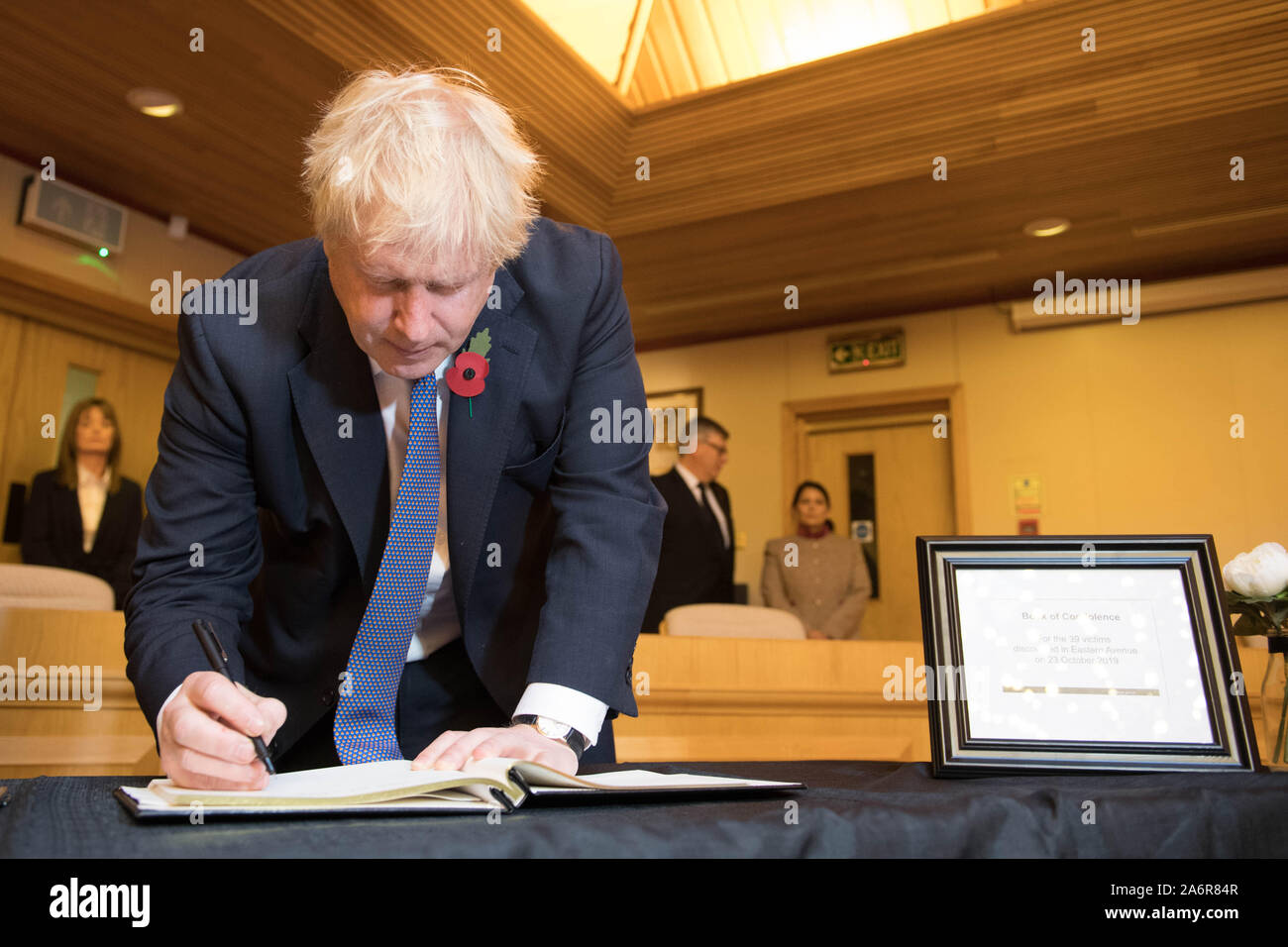 Prime Minister Boris Johnson signs a book of condolence, during a visit to Thurrock Council Offices in Essex after the bodies of 39 people were found in a lorry container last week. Stock Photo