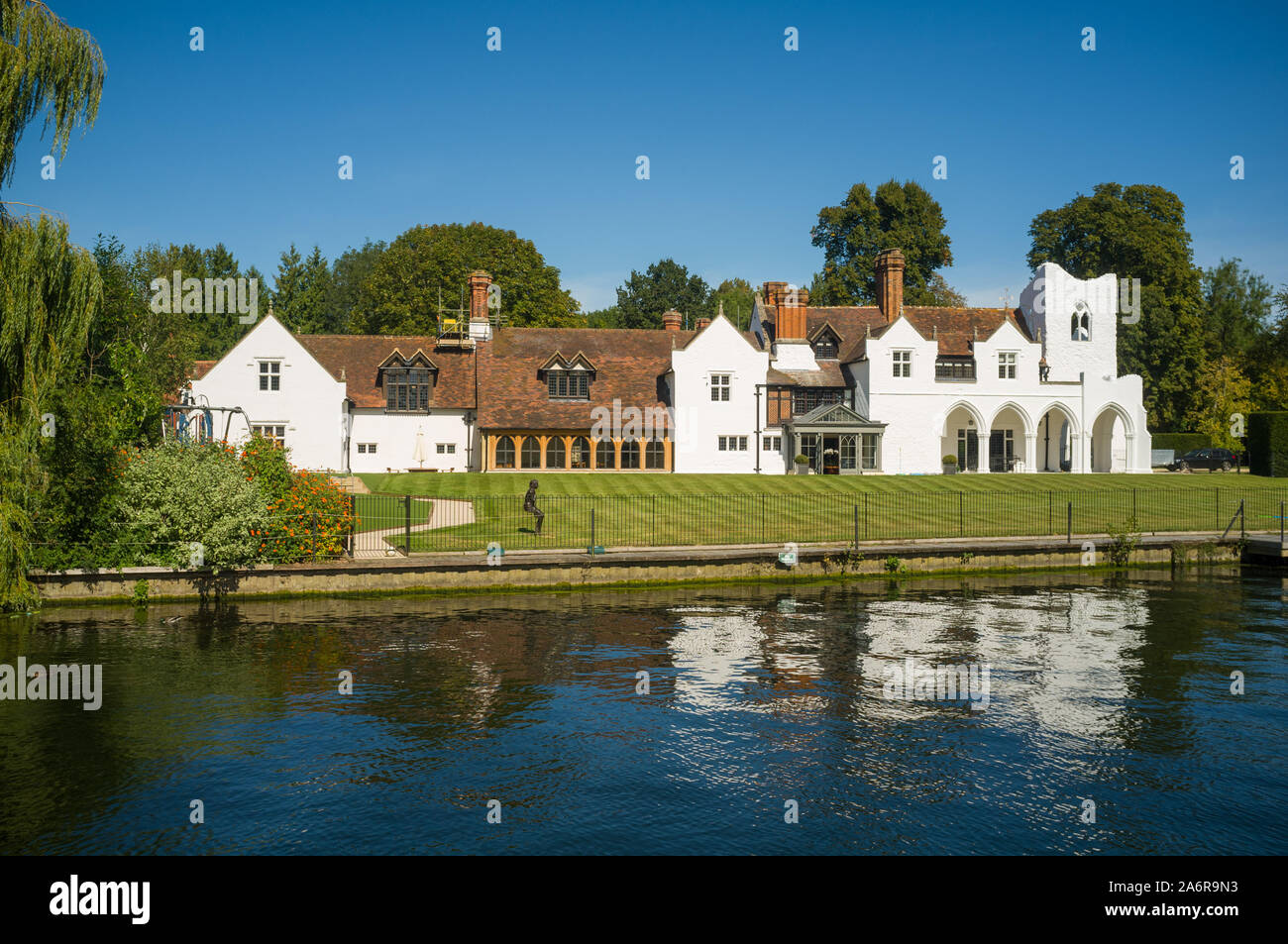 Medmenham Abbey, a private house on the site of a Cistercian Abbey by the Thames between Henley-on-Thames and Marlow under  a clear bright blue sky Stock Photo