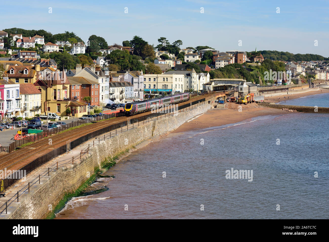 An up Cross Country Voyager train passing through Dawlish, as work begins to strengthen the sea wall. Stock Photo