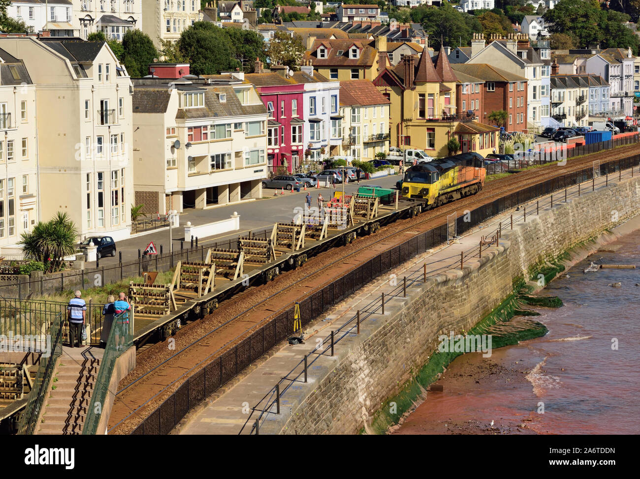 An empty Colas Rail Freight cwr train passing through Dawlish top and tailed by Class 70 locomotives Nos 70812 (front) and 70808. Stock Photo