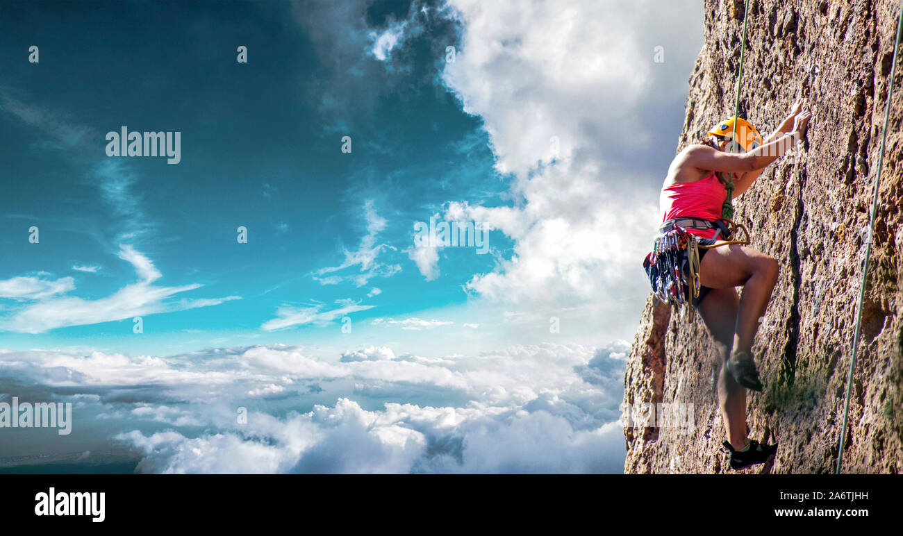 Murcia, Spain, September 27, 2019. One sportswoman mountain climbing. Physical activity in the countryside. Risky sports. Mountain climb or climbing i Stock Photo