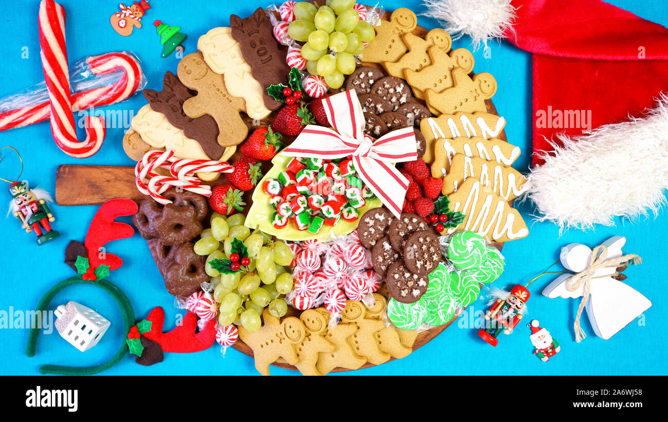 Happy Holidays Christmas Bright Colorful Large Dessert Grazing Platter Charcuterie Board With Gingerbread Cookies Candy And Fruit On Bright Pop Colo Stock Photo Alamy