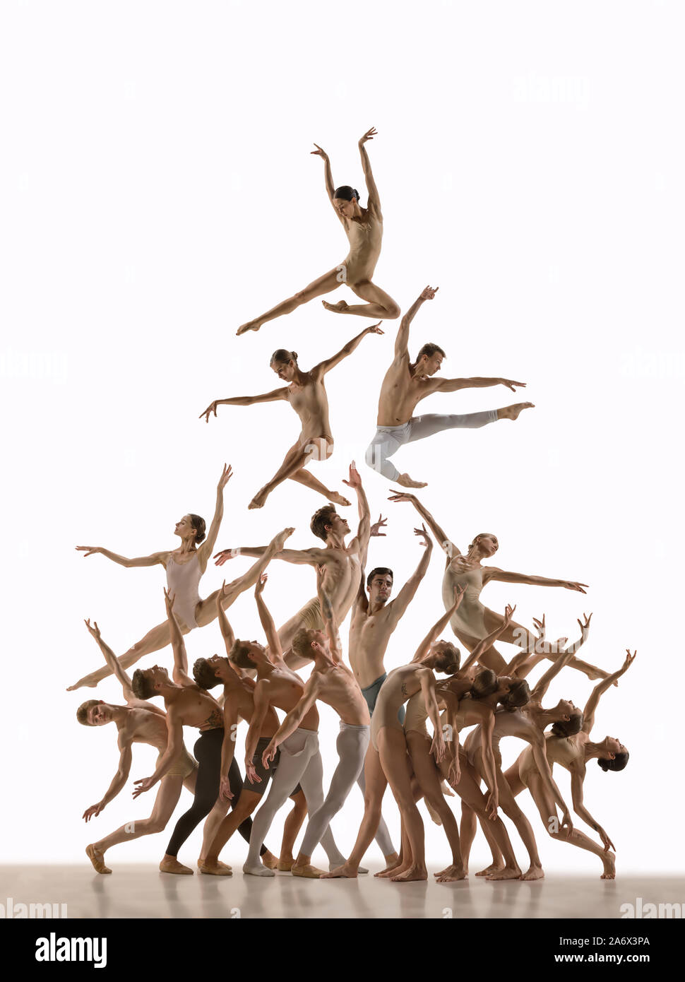 The group of modern ballet dancers. Contemporary art ballet. Young flexible  athletic men and women in tights. Negative space. Concept of dance grace,  inspiration, creativity. Made of shots of 11 models Stock