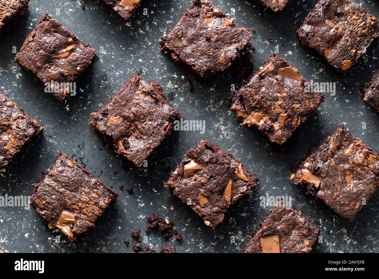 Chocolate brownies on mottled grey and white background - top view Stock Photo