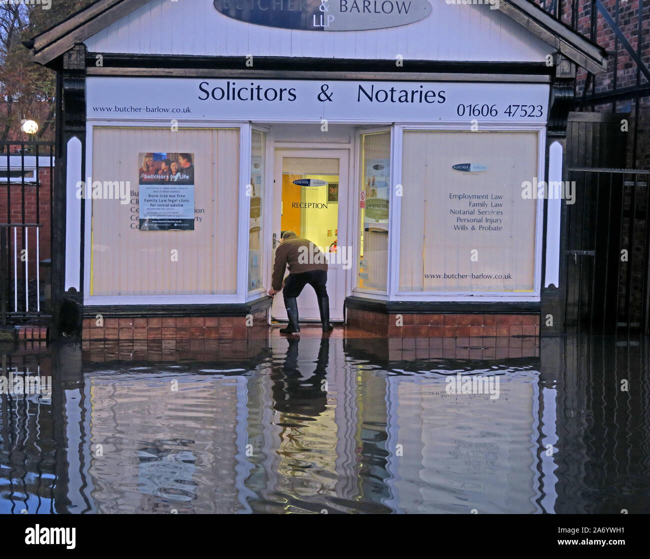 Severe flooding in Northwich Town, Chester way, River Weaver October 2019, Cheshire, England, UK - sand bags at Butcher Barlow Solicitors Notaries Stock Photo