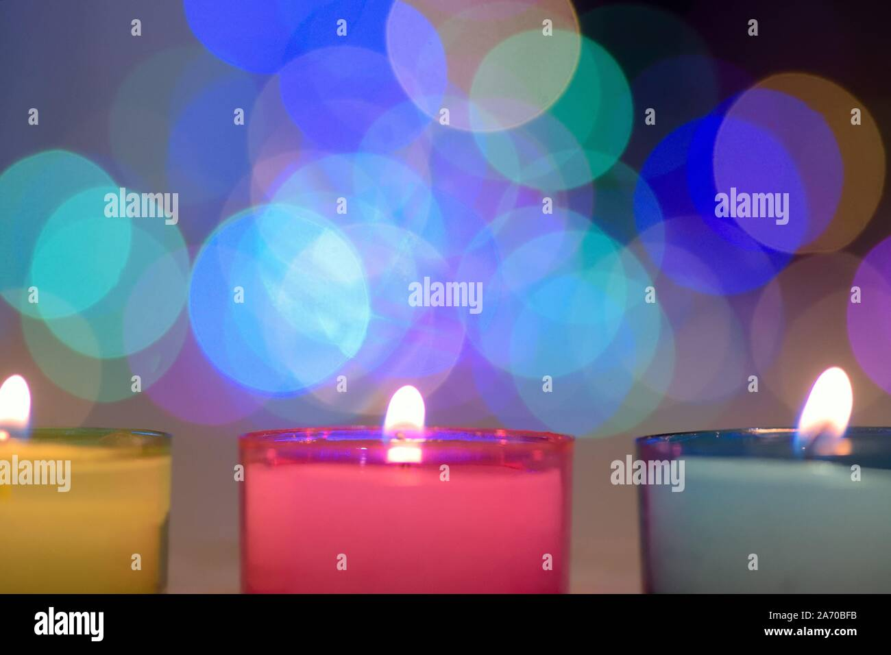 Colorful Candles with blurred background lights Stock Photo