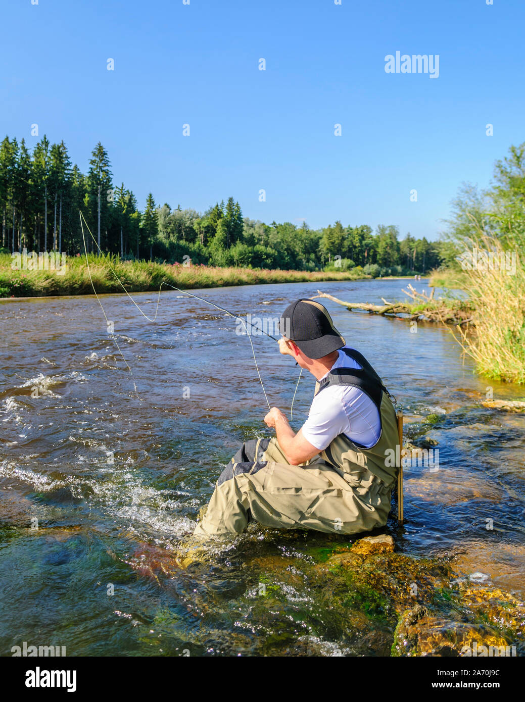 Flyfisher in action Stock Photo