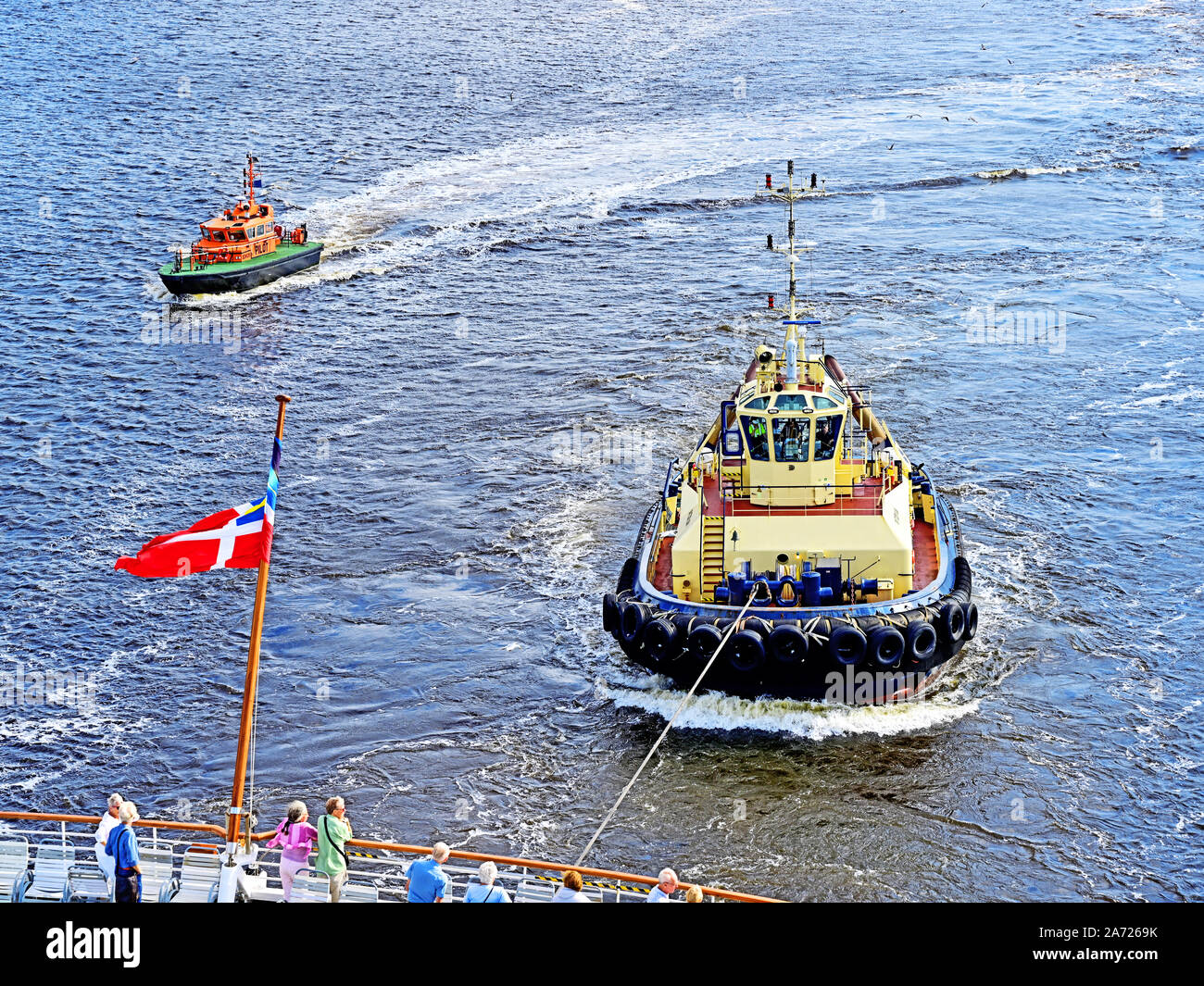 River Tyne Port of Tyne pilot boat Bewick and tug Svitzer Sun with the Fred Olsen Balmoral cruise ship Stock Photo
