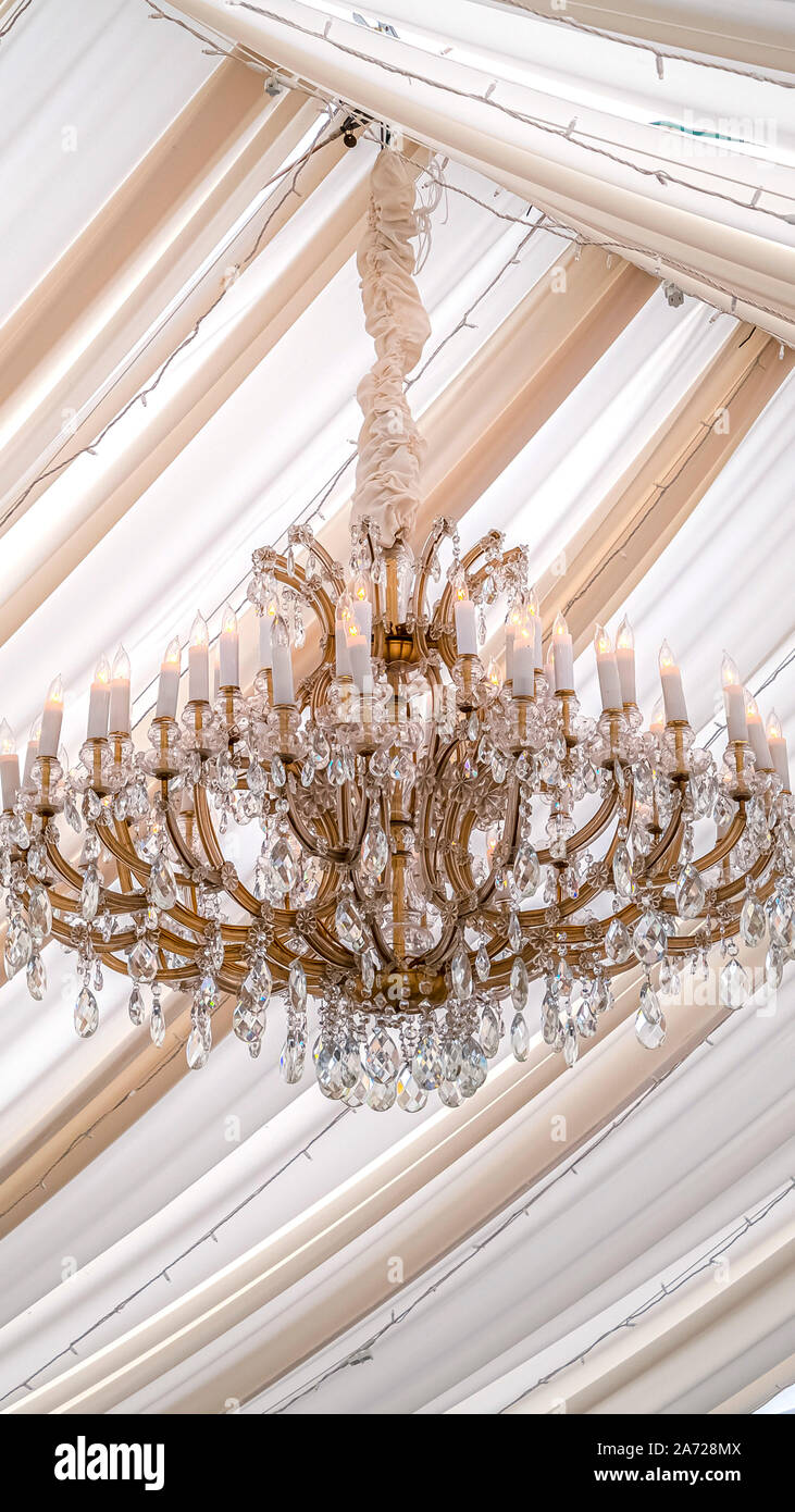 Vertical Beautiful Chandelier With Crystals And Faux Candles At A Wedding Venue Stock Photo Alamy