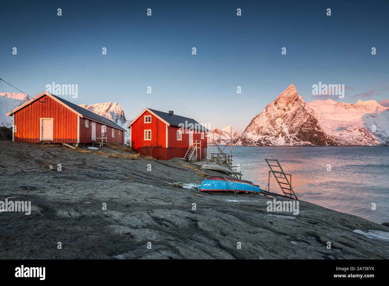 Red fishermen's huts and Olstinden mountain, Lofoten, Norway Stock Photo