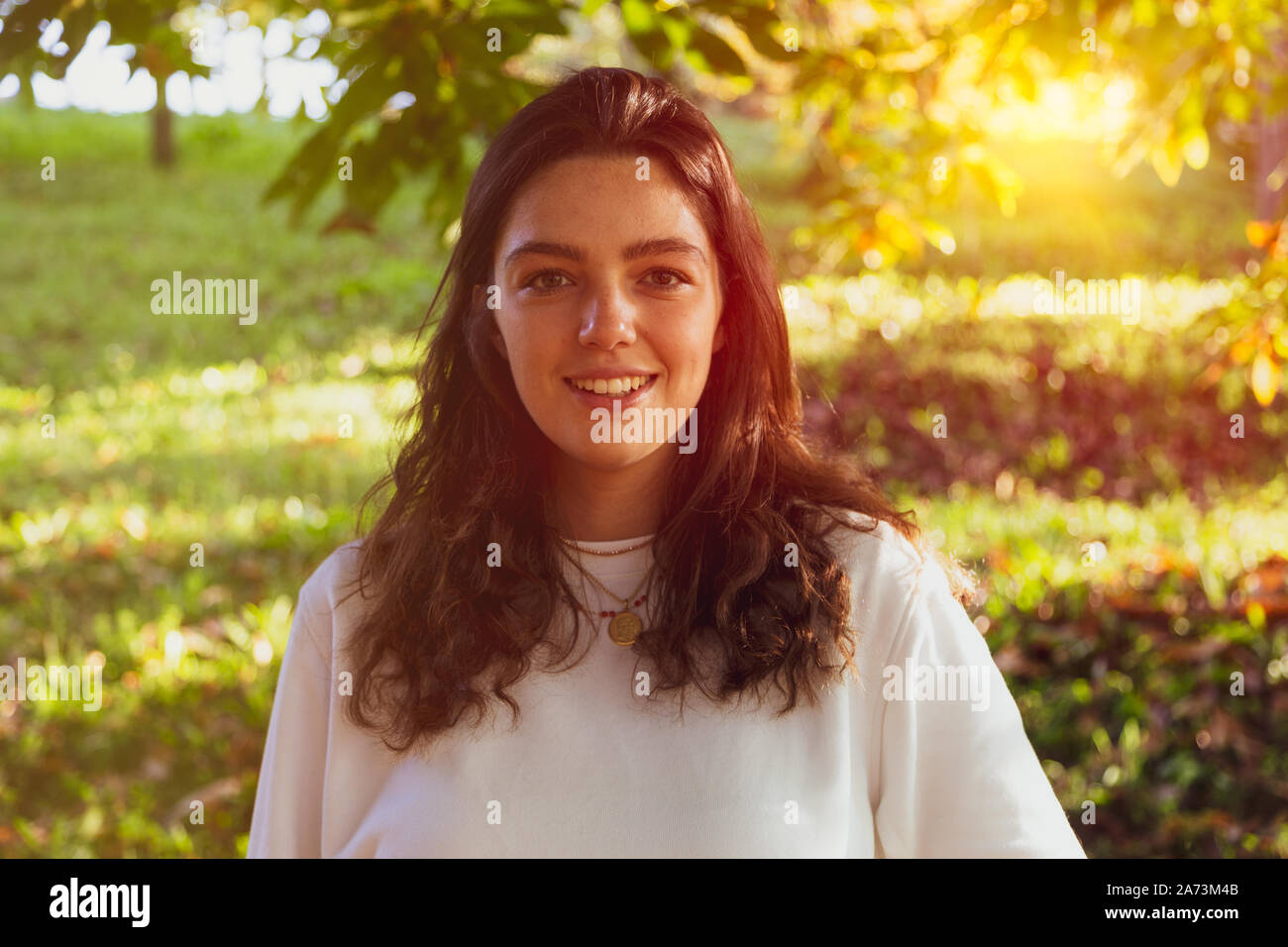 Young woman smiling in nature Stock Photo