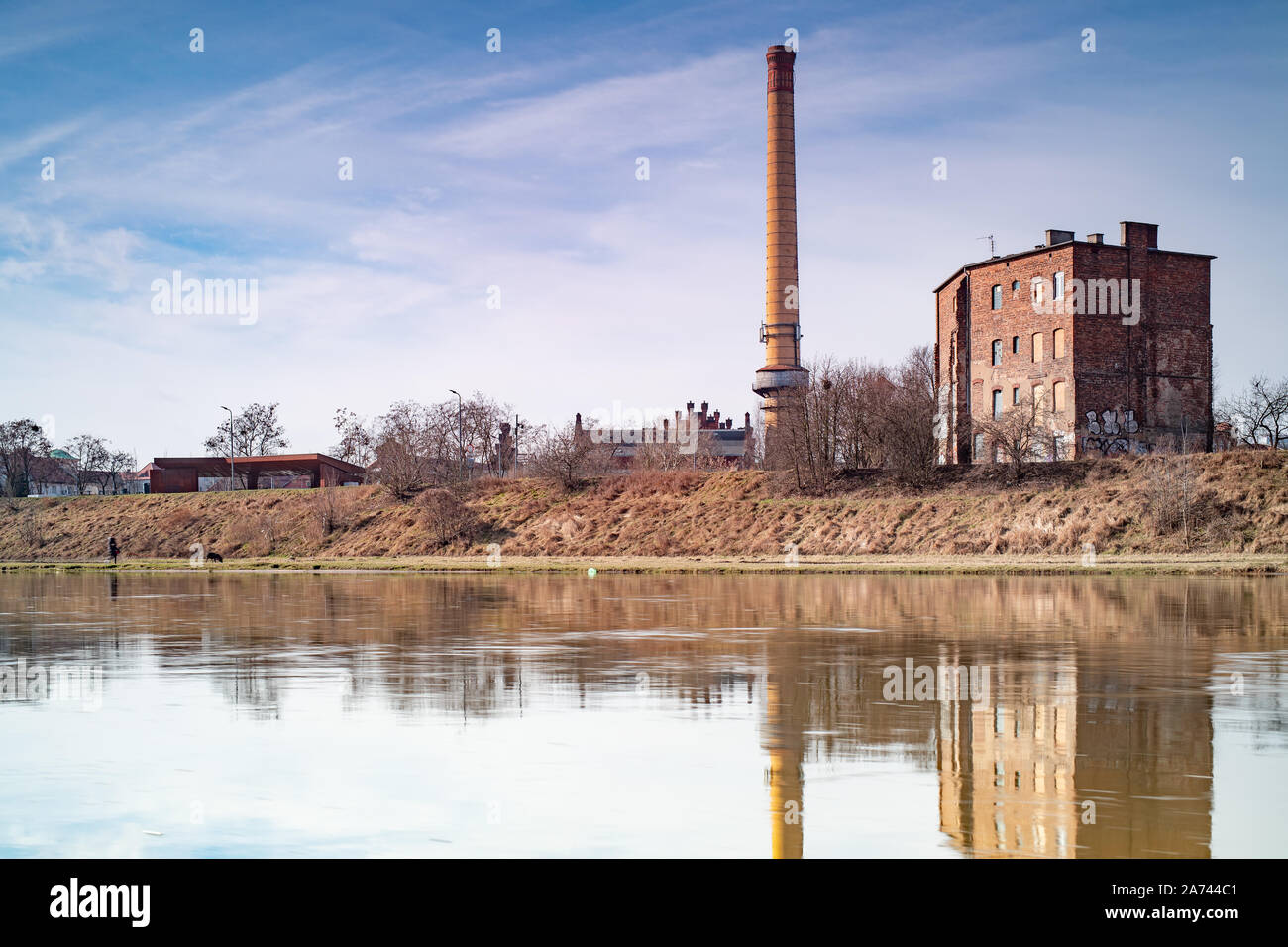 Poznan - industrial buildings and Warta river, spring. Poland Stock Photo