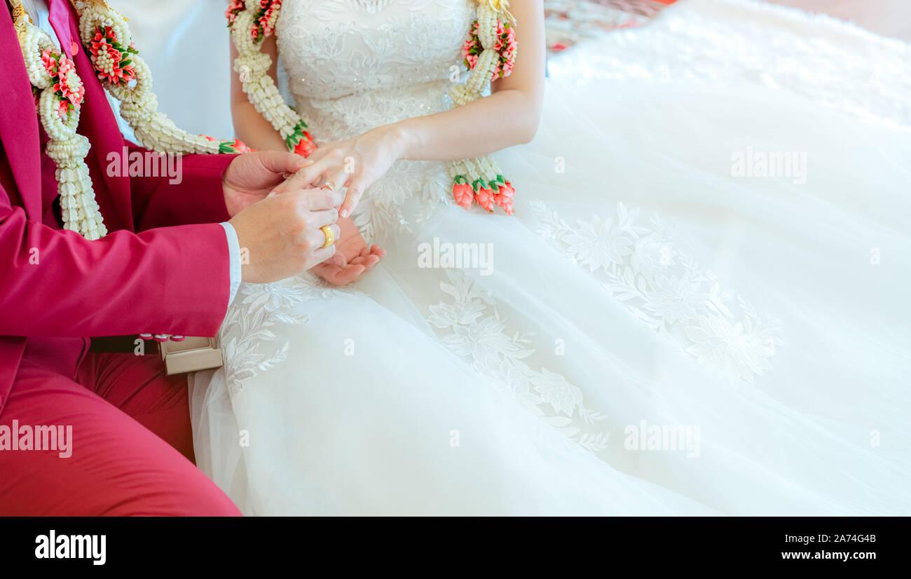 Groom Put Wedding Diamond Ring On Bride Finger For Proposal On