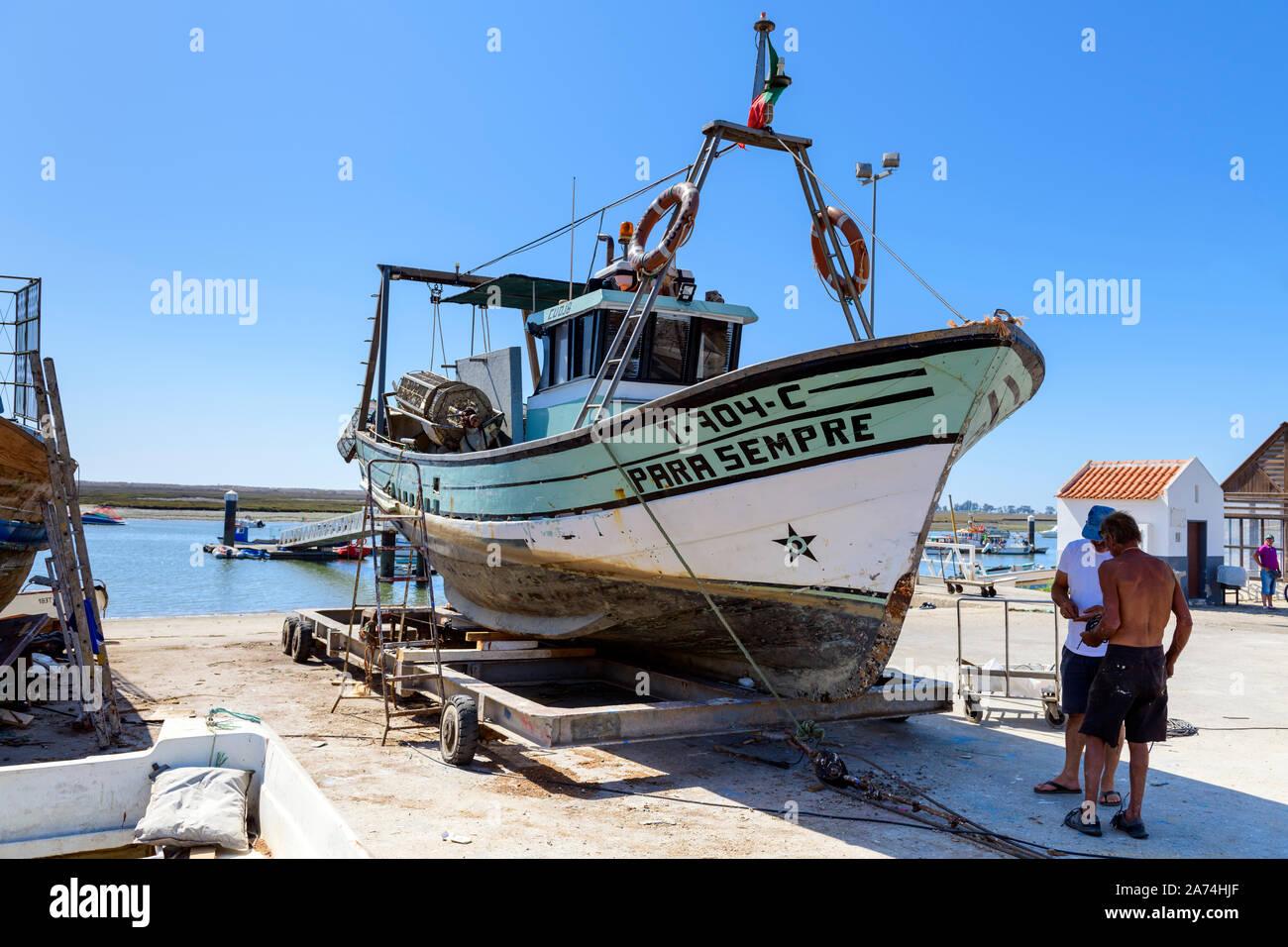 09.16.2019. Algarve, Portugal. Fishing boat under repair, Santa Luzia, East Algarve Stock Photo