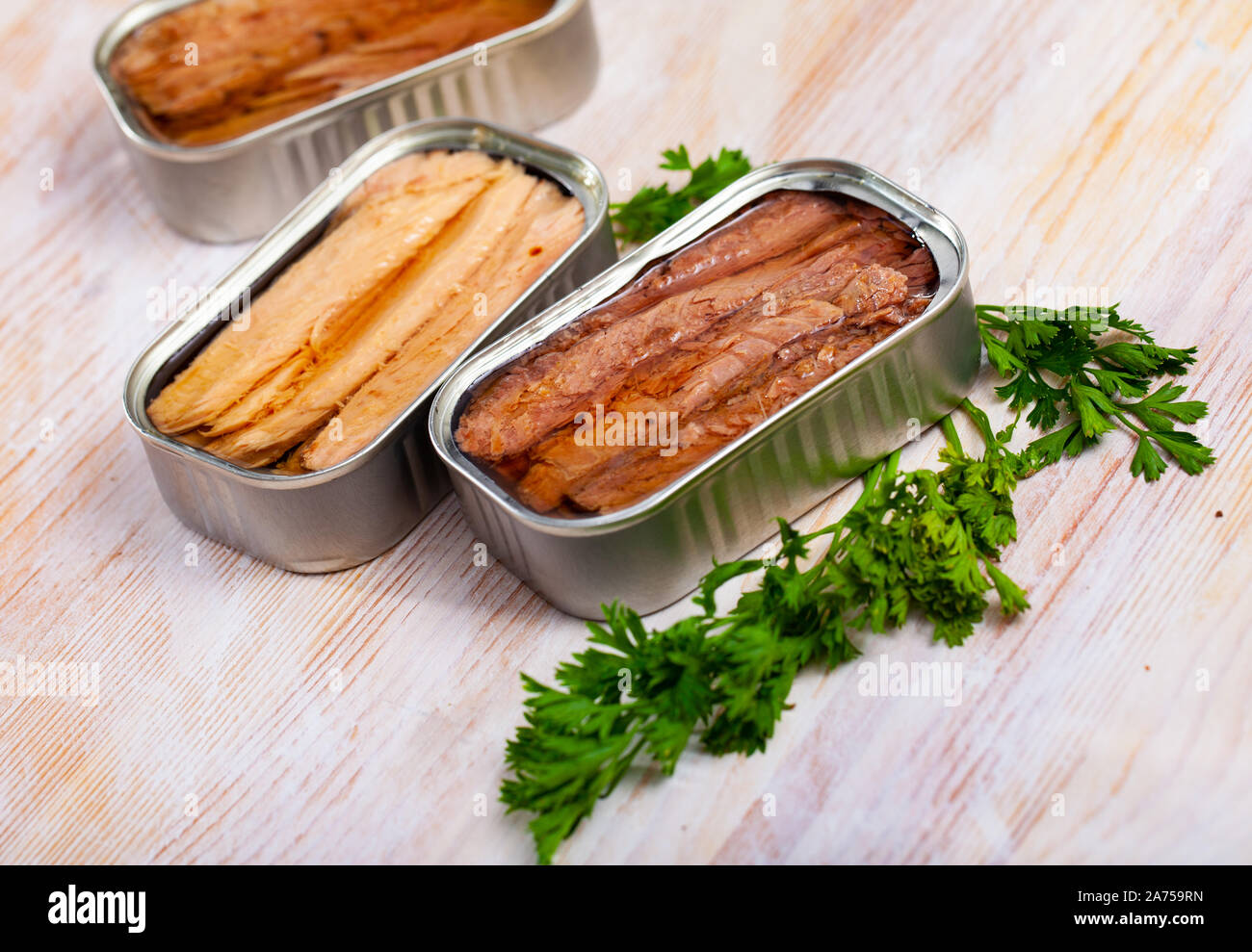 Canned seafood, Andalusian melva fish fillets preserved in oil on wooden table Stock Photo