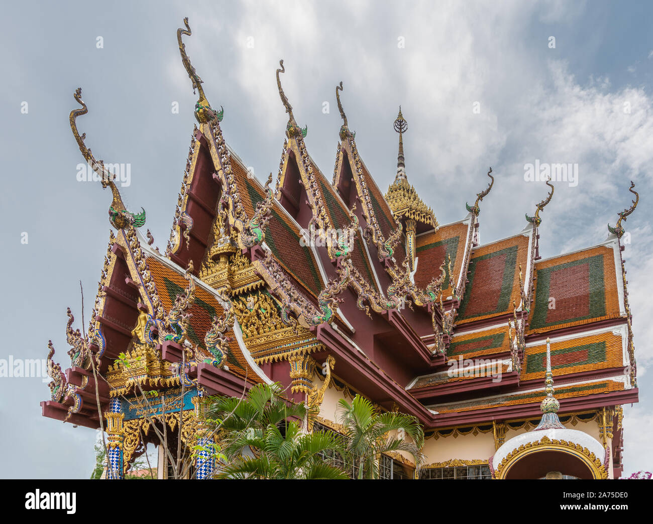 Ko Samui Island, Thailand - March 18, 2019: Wat Laem Suwannaram Chinese Buddhist Temple. Elaborately decorated multi-leveled roof structure with gold, Stock Photo