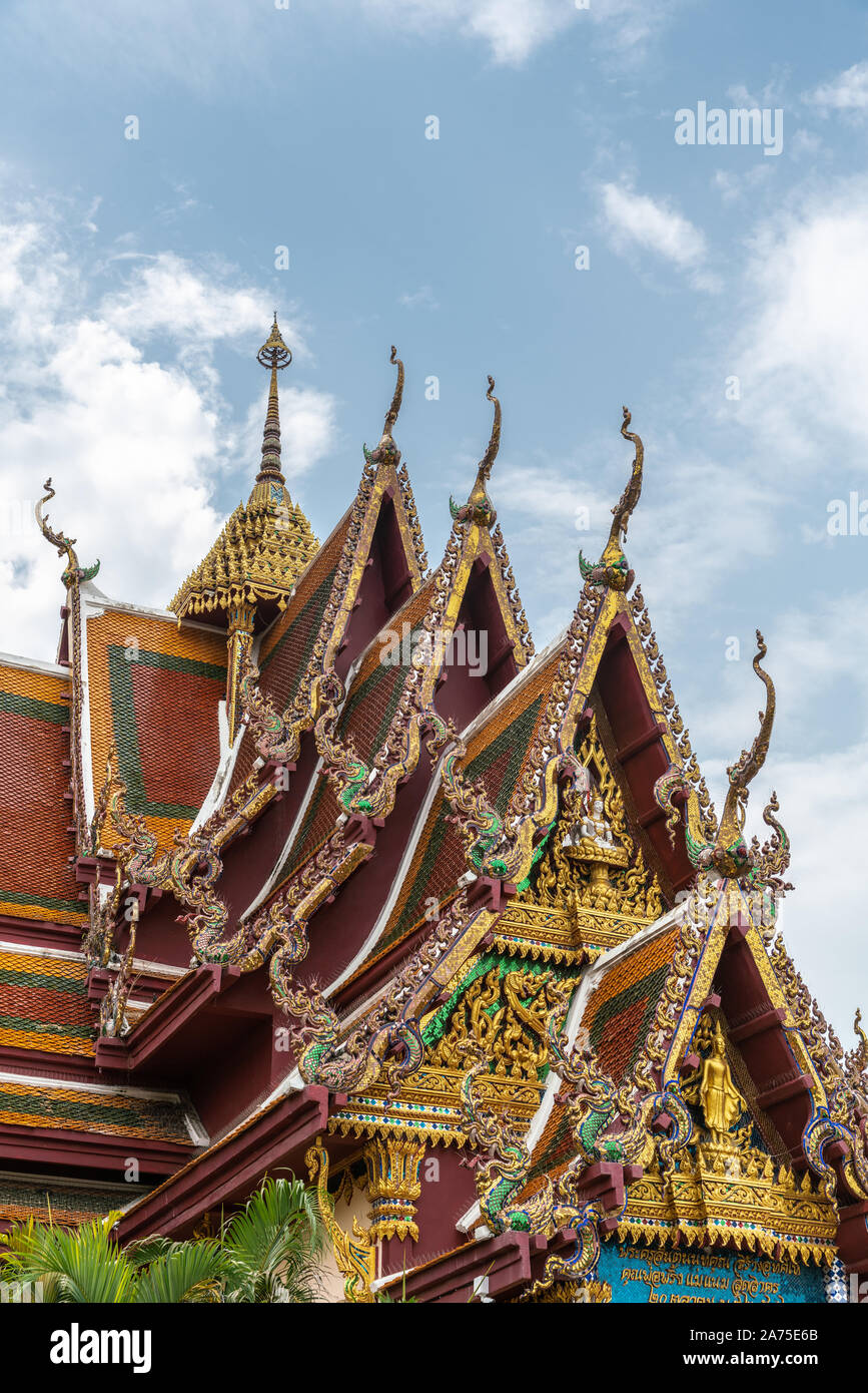 Ko Samui Island, Thailand - March 18, 2019: Wat Laem Suwannaram Chinese Buddhist Temple. Elaborately gold decorated full of colors front gables with s Stock Photo